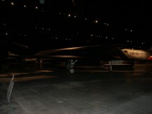 dark photograph of an airplane indoors